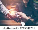 young man hands are smartphone...   Shutterstock . vector #1215034231