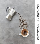 coffee beans pour in a cap with ... | Shutterstock . vector #1215066901