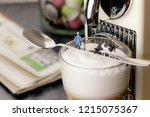 dairy farmer with a cow on a... | Shutterstock . vector #1215075367