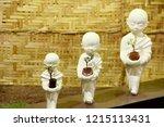 Small Buddha Statues Holding...