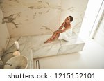 cheerful young woman in hammam... | Shutterstock . vector #1215152101