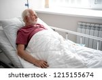 waiting for doctor. side view... | Shutterstock . vector #1215155674