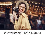 Stock photo lady with puppy cute pretty young lady wearing stylish hat and smiling while hugging adorable 1215163681