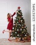 elegant woman decorating the... | Shutterstock . vector #1215173491