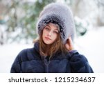 beautiful young girl in a blue... | Shutterstock . vector #1215234637