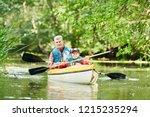 kayaking on river in forest.... | Shutterstock . vector #1215235294