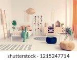boho kid's bedroom with white... | Shutterstock . vector #1215247714