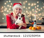 woman with dog at christmas hat.... | Shutterstock . vector #1215250954