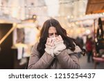 woman blowing nose while... | Shutterstock . vector #1215254437