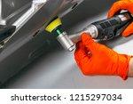 car polish wax worker hands... | Shutterstock . vector #1215297034