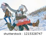 family sledding in winter with... | Shutterstock . vector #1215328747
