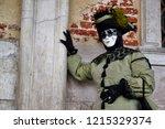 carnival green black mask and... | Shutterstock . vector #1215329374