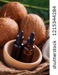 coconut oil with coconuts  ...   Shutterstock . vector #1215344284