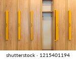 wooden lockers with yellow... | Shutterstock . vector #1215401194