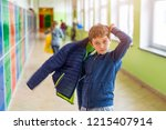 child boy dressing his autumn... | Shutterstock . vector #1215407914