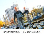 construction workers at... | Shutterstock . vector #1215438154