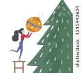 girl decorate a christmas tree. ... | Shutterstock .eps vector #1215442624