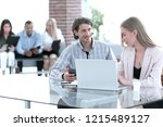 manager is talking to in the... | Shutterstock . vector #1215489127