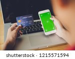 hand holding a credit card in... | Shutterstock . vector #1215571594
