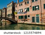 view of houses and canal street ... | Shutterstock . vector #1215574894