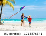 child running with colorful... | Shutterstock . vector #1215576841