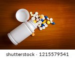 pills and vial on the table... | Shutterstock . vector #1215579541
