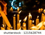 lit up candles to honor and... | Shutterstock . vector #1215628744