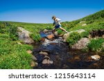 traveler with camera on stone... | Shutterstock . vector #1215643114