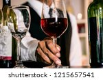 Hand Waiter Pouring Red Wine I...