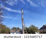 concrete pole with a lantern....   Shutterstock . vector #1215685717