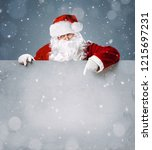 santa claus pointing in blank... | Shutterstock . vector #1215697231