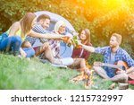 friends on camping making toast ... | Shutterstock . vector #1215732997