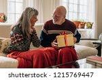 senior man giving a christmas...   Shutterstock . vector #1215769447
