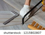 man sawing laminate | Shutterstock . vector #1215802807