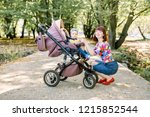 young mother looking at her... | Shutterstock . vector #1215852544