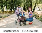 mom feeding her baby girl with... | Shutterstock . vector #1215852601