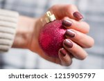 girl with brown manicure nails... | Shutterstock . vector #1215905797