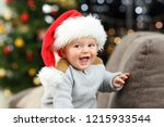 joyful baby looking at camera... | Shutterstock . vector #1215933544