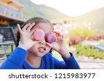 little asian child girl playing ... | Shutterstock . vector #1215983977