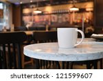 Stock photo closeup of a cup of coffee at coffee shop 121599607