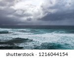 dark storm clouds above rough... | Shutterstock . vector #1216044154