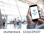 airport free wifi zone. man... | Shutterstock . vector #1216129237