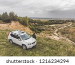 white suv at the top of the... | Shutterstock . vector #1216234294