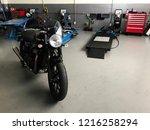 motorbike garage in phitsanulok ...   Shutterstock . vector #1216258294