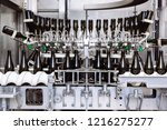 glass bottles on the automatic... | Shutterstock . vector #1216275277