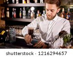 barman making alcohol coffe... | Shutterstock . vector #1216294657