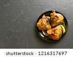 roasted chicken thighs on plate ... | Shutterstock . vector #1216317697