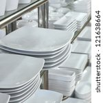 a lot of white plates in a shop   Shutterstock . vector #121638664