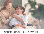 smiling nurse helping happy... | Shutterstock . vector #1216394251