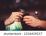 male hands cheers with alcohol... | Shutterstock . vector #1216419217